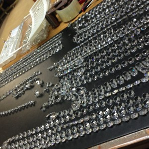 Piecing crystals together for a crystal chandelier